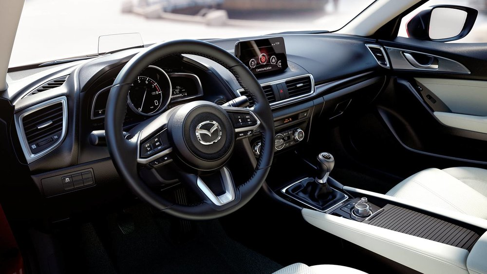 The interior of the Mazda3 is nicely laid out, with intuitive steering wheel controls.