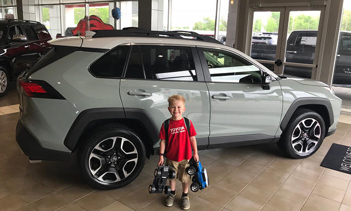 A Gift to Remember –    Holden poses in front of the 2019 RAV4. Laukes presented Holden's family with a new RAV4 as a thank you for their decades of loyalty to the brand.