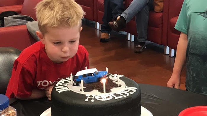 Make a Wish –    Holden blows out the candles on his birthday cake, topped with a miniature FJ Cruiser.