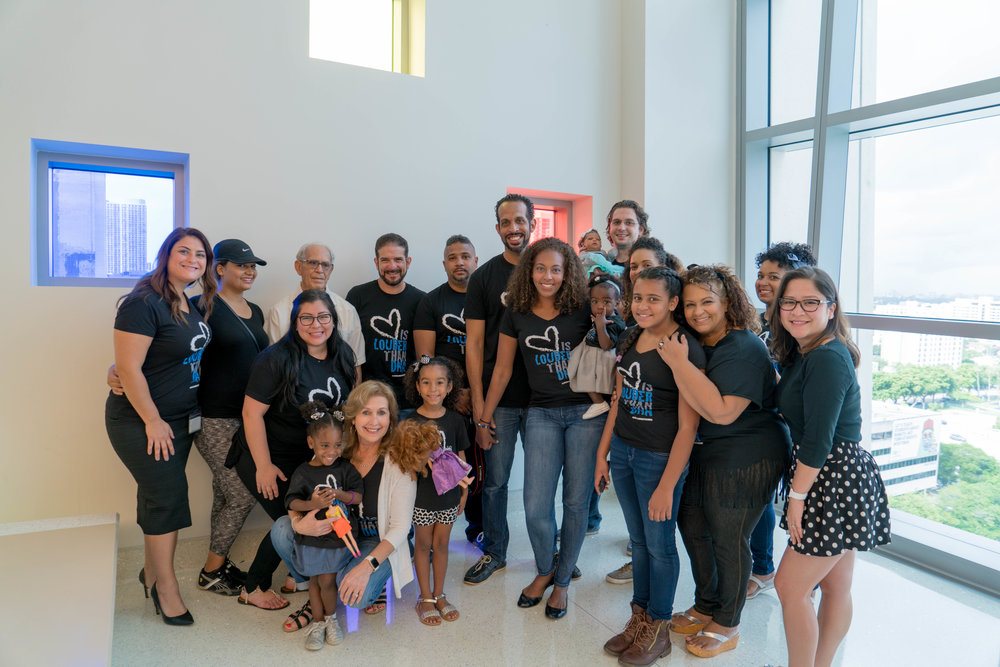 Our support. Friends and family came to celebrate our daughter's adoption day with us at Miami Children's Courthouse.  Photograph by Ben Velazquez