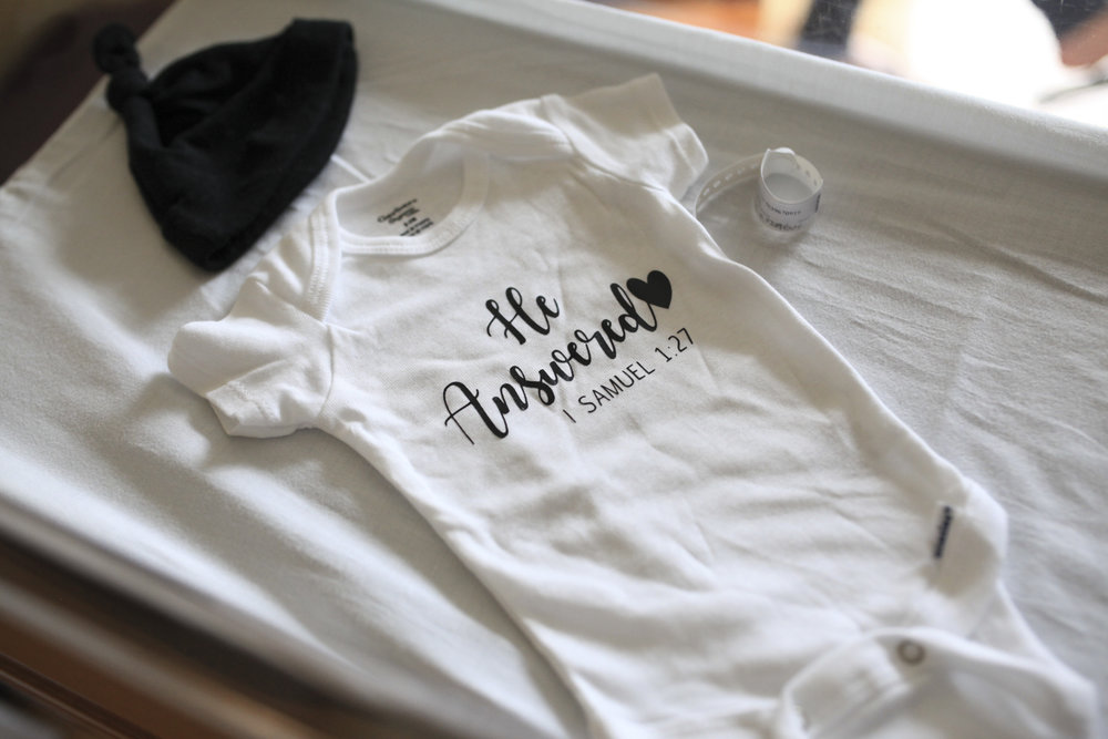 After waiting for a child, parents made a onesie with a special bible verse.