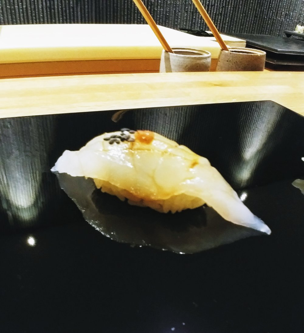 Bass grouper - Love how Chef Minamishima decides to continue the citrus note by incorporating ponzu sauce and yuzu zest but not overpowering the flavour of the fish which has the perfect texture that elevates the sushi to a whole new level #mytopfavourites