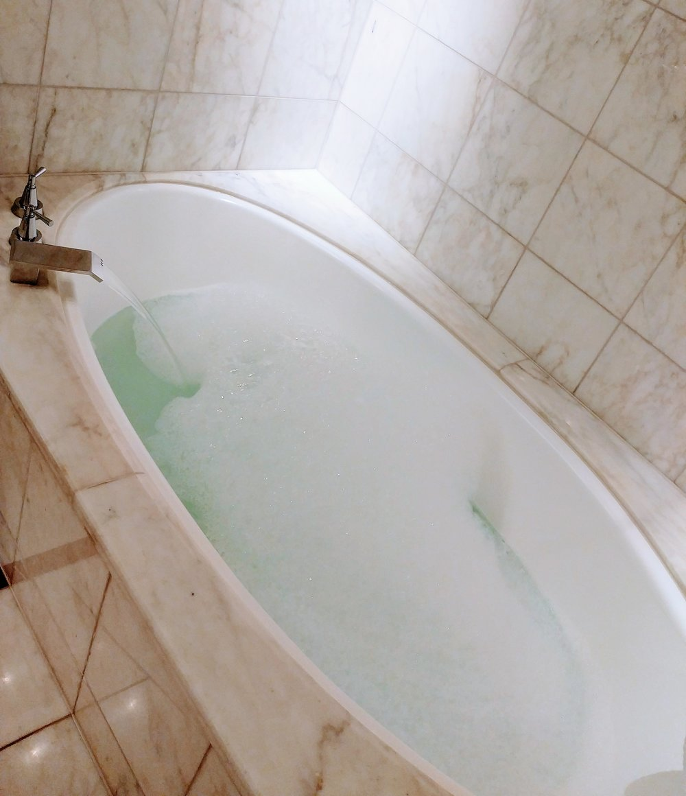 Did I mention that the bathtub is absolutely gigantic? Definitely can fit two people in here!