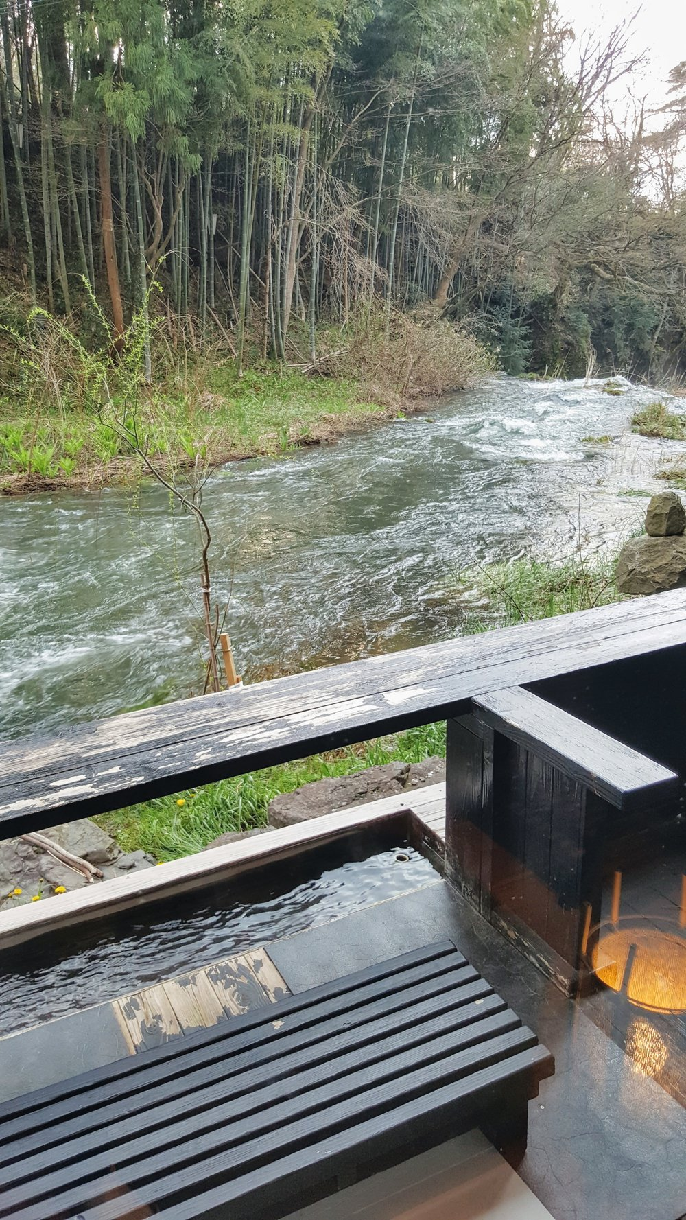 Public foot bath facing the mountain and river stream