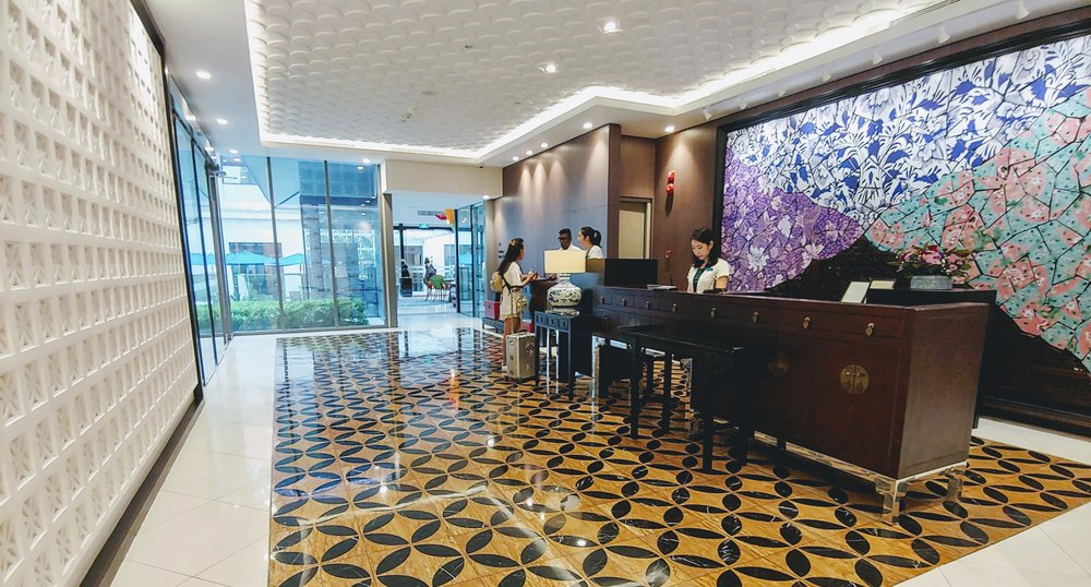 Love the feature wall consisting of Peranakan ceramic patterns and even the reception desk replicates the vintage cabinets