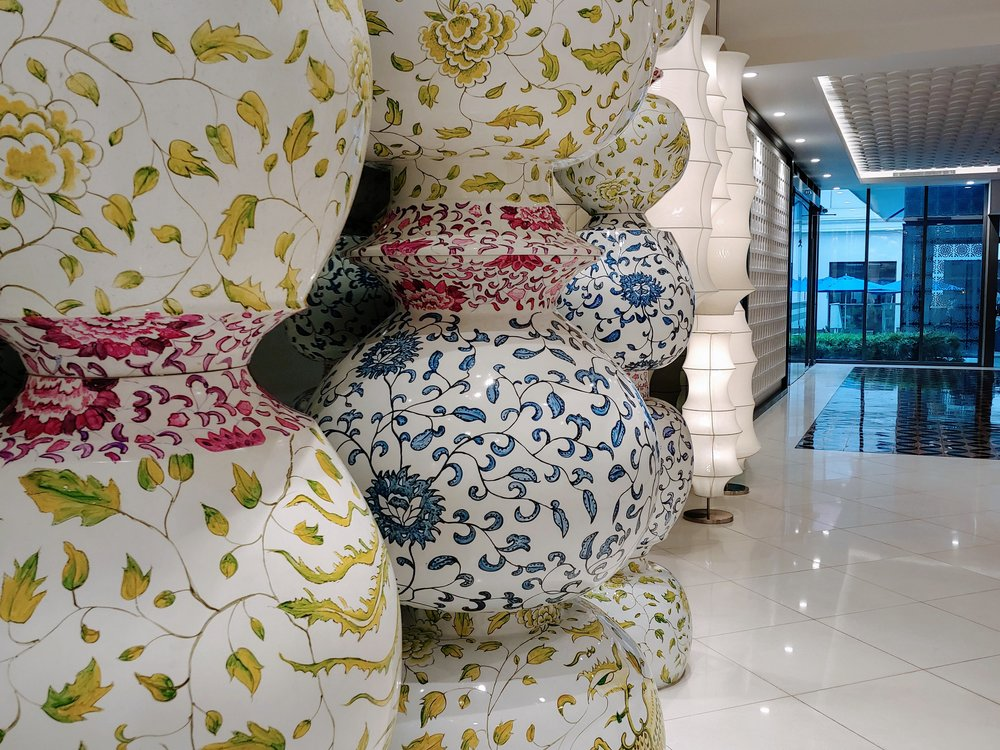Stacks of the ceramic pots in front of the lifts, what an extraordinary art piece!