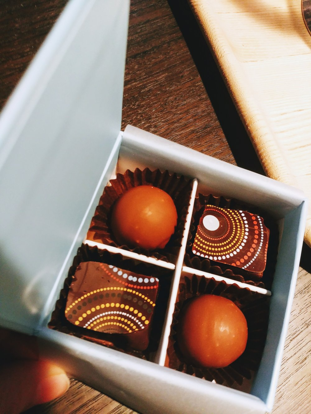 A small box of chocolate from their on-site chocolate shop awaiting in our room