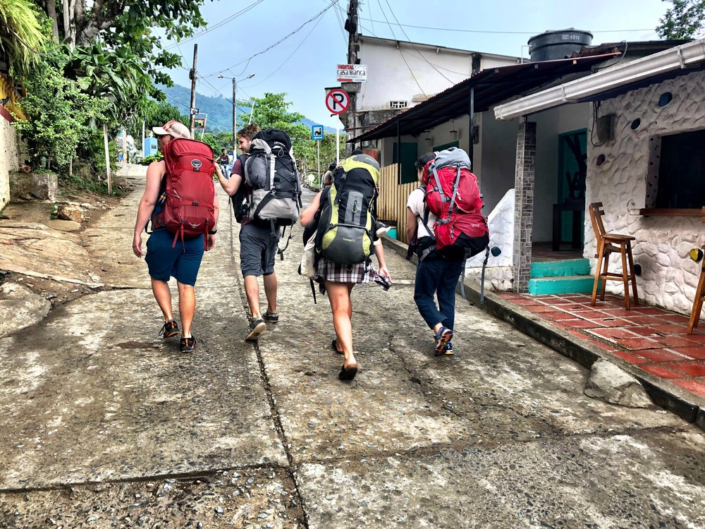 Band of backpackers in Minca, Colombia heading to the most amazing and cheap hostel there— Hostal Casa Loma Minca .