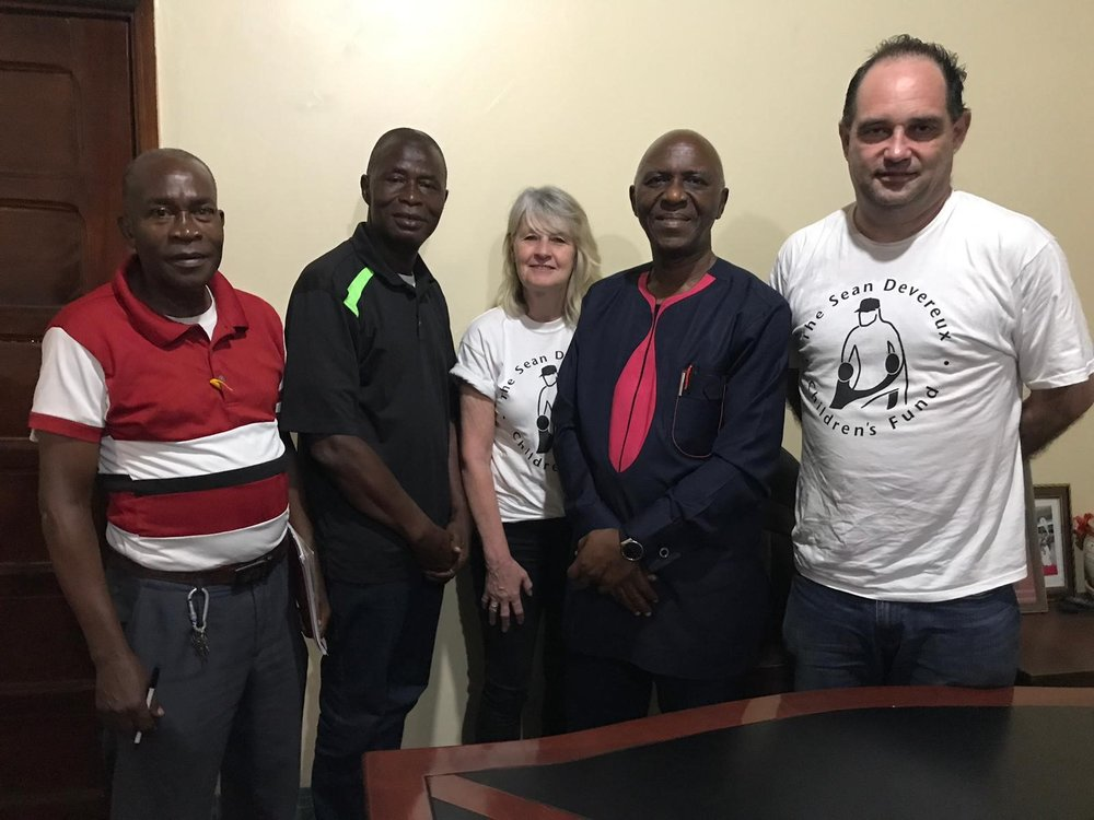 Mark and Theresa pictured with David Flower (far left), Amadu and the Liberian Education minister