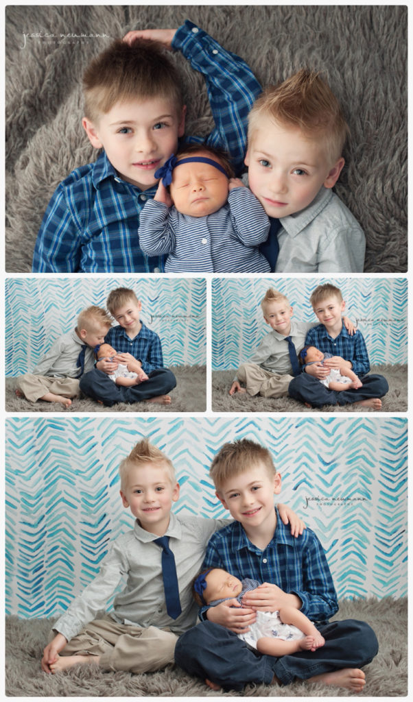 siblings in blue brothers with newborn baby sister
