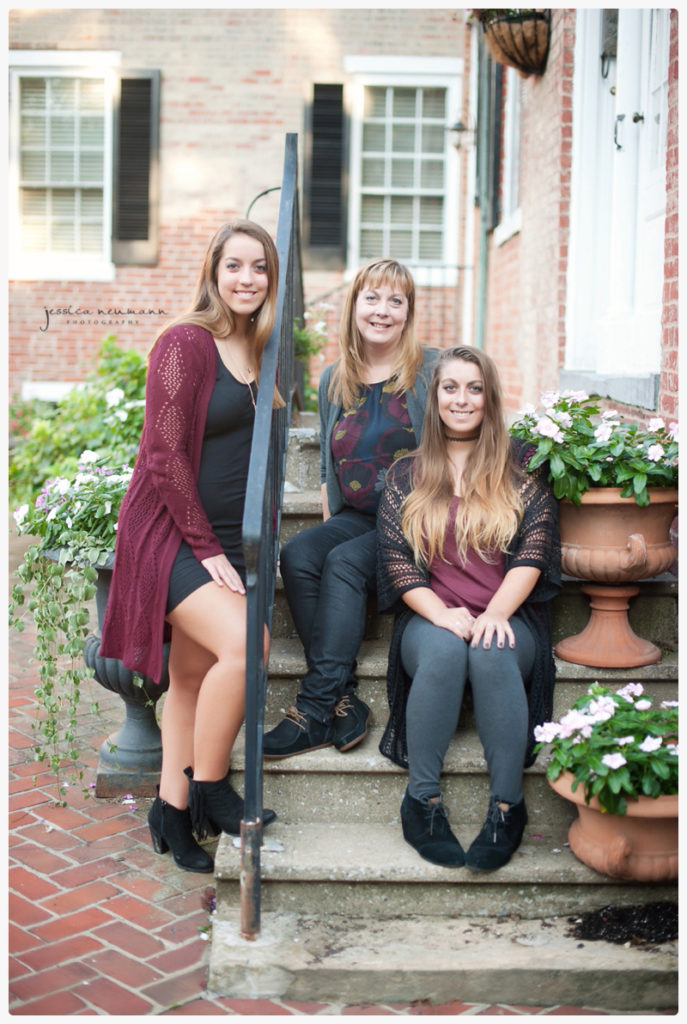 mom with her teenage girls in urban setting