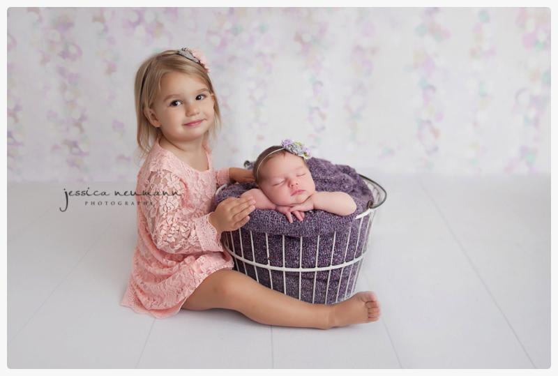 newborn and sister studio