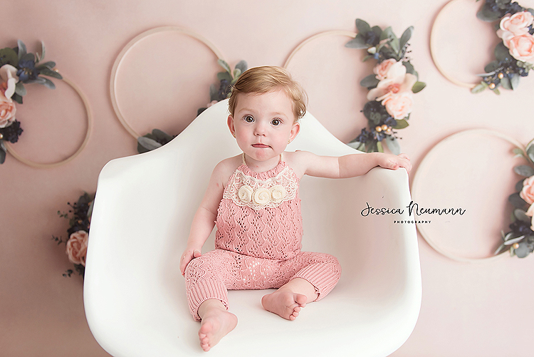 baby in white chair