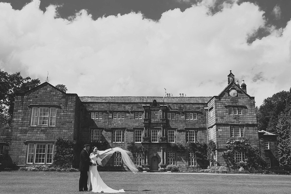 browsholme hall wedding photo of bride throwing veil