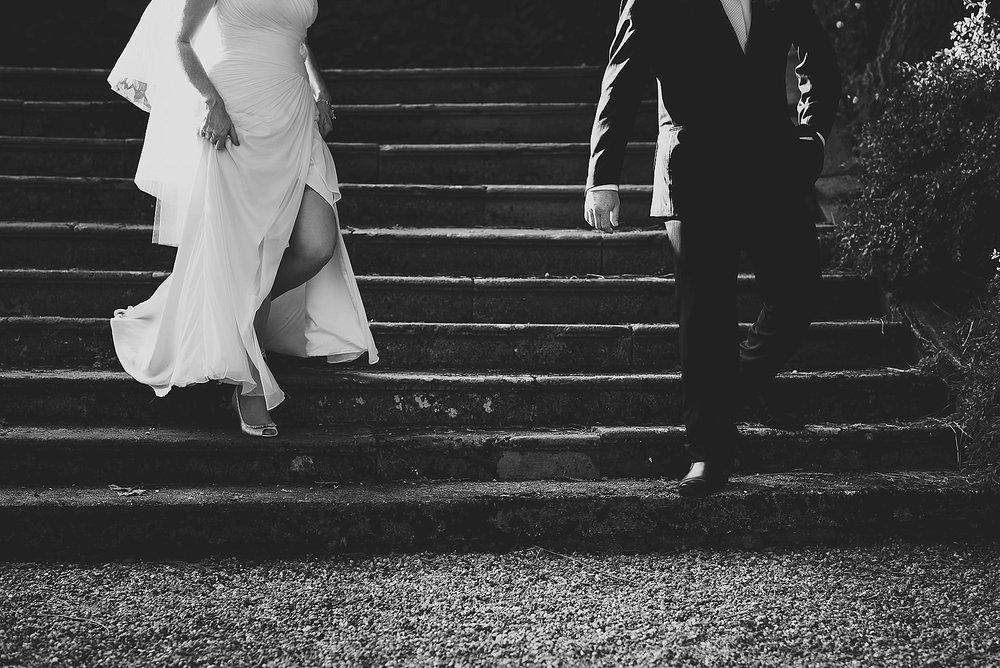 surreal photo of bride and groom walking down steps