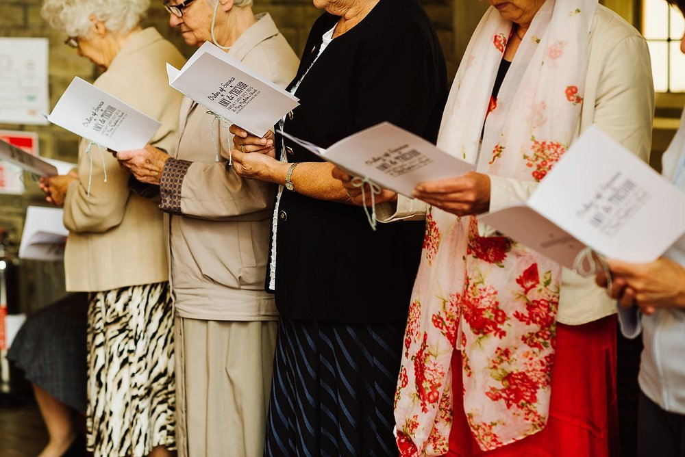 old women reading the order of service