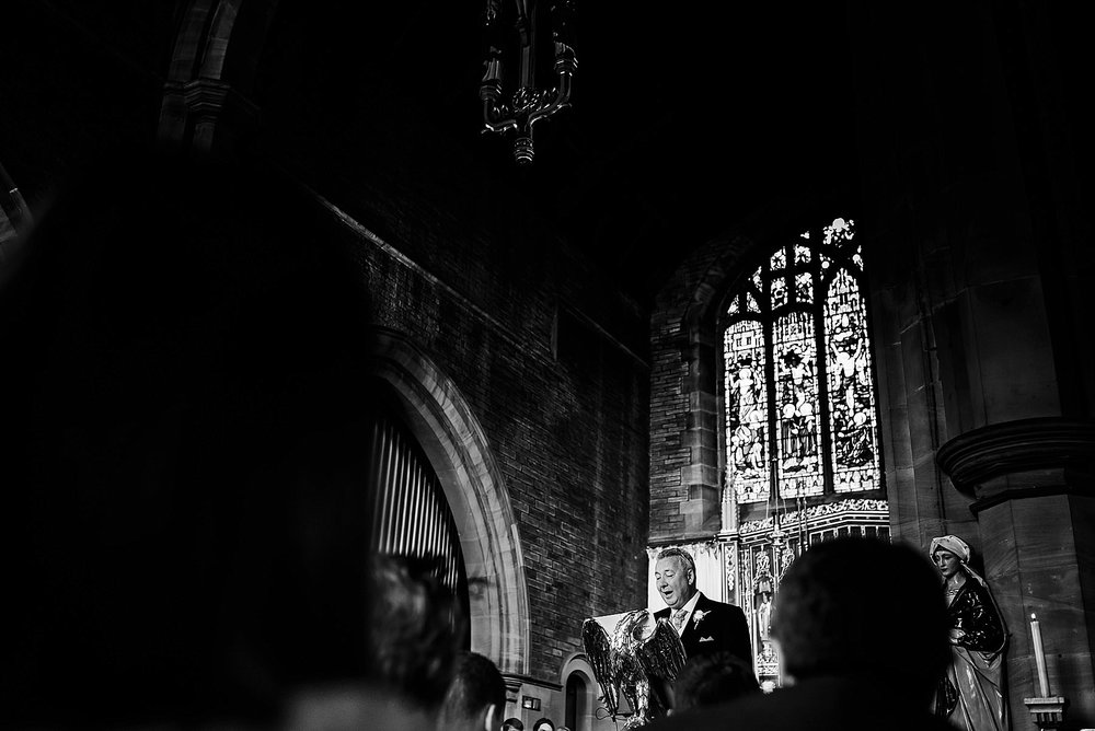 Man doing a reading at the wedding ceremony