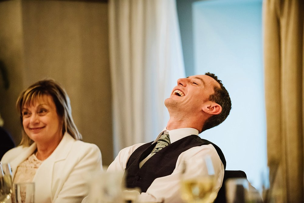 groom-laughing at best man's speech