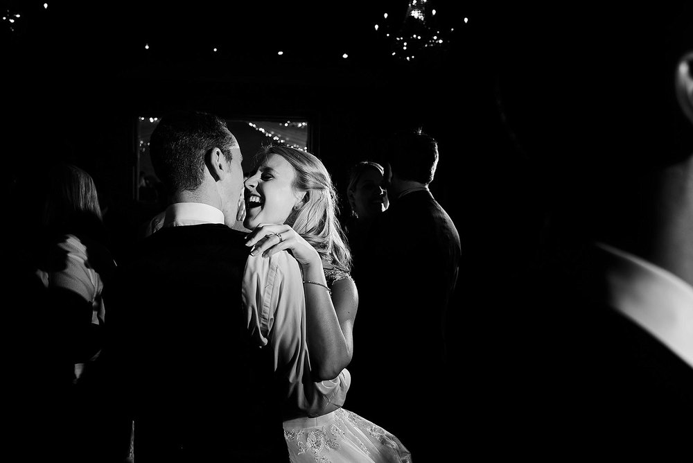 black and white image of the bride and groom having their first dance
