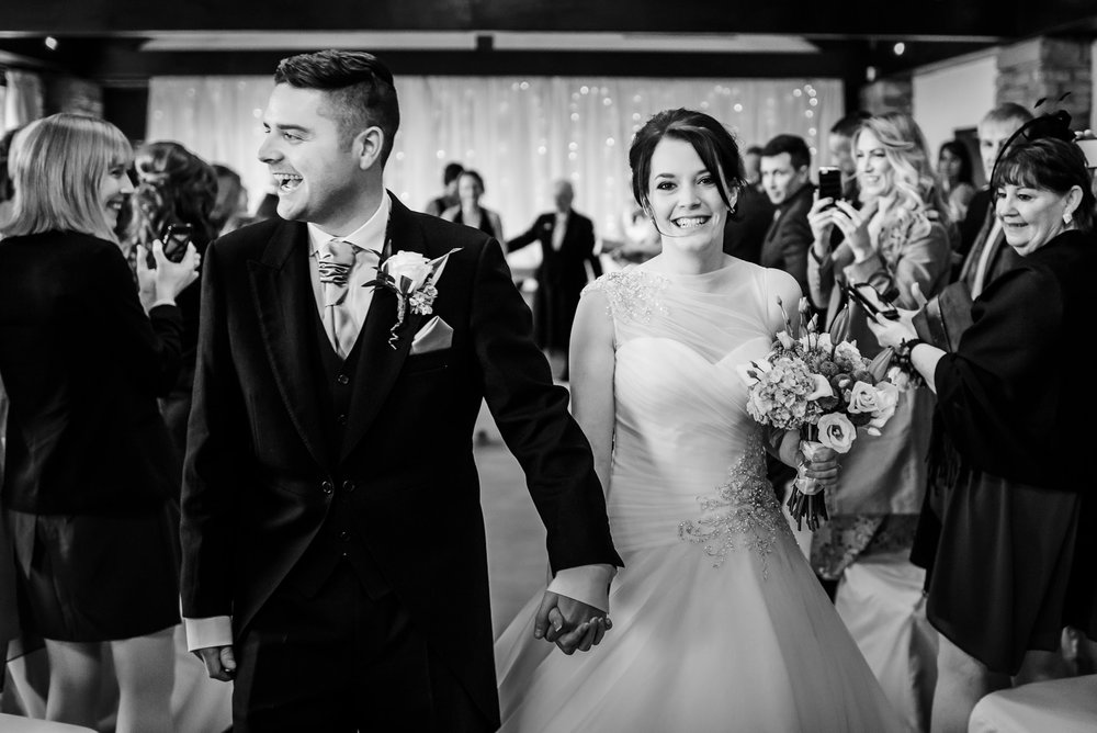 Amy & Jon walking down the aisle together at Mitton Hall