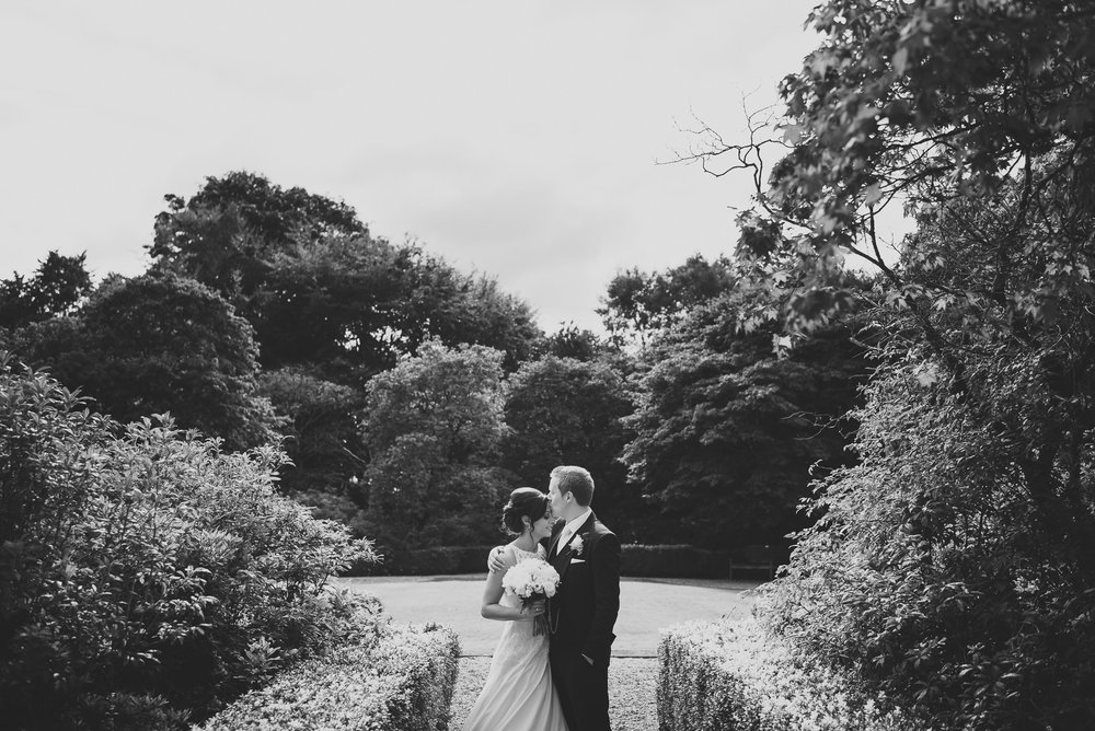In the gardens of Eaves hall, a wedding photograph of Rowena and Stuart