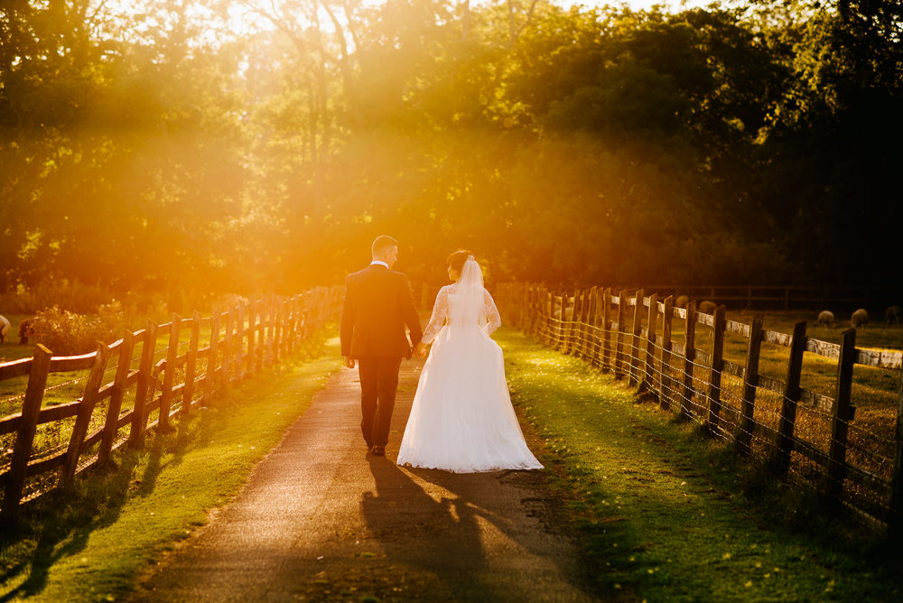 wedding photo with  a beautiful sunset at the villa in wrea green