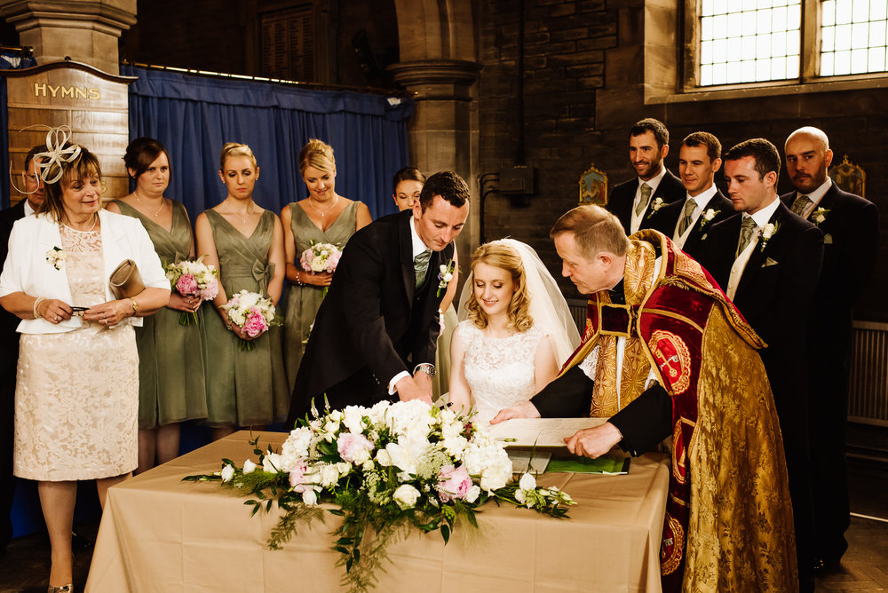 Signing the register on a wedding day