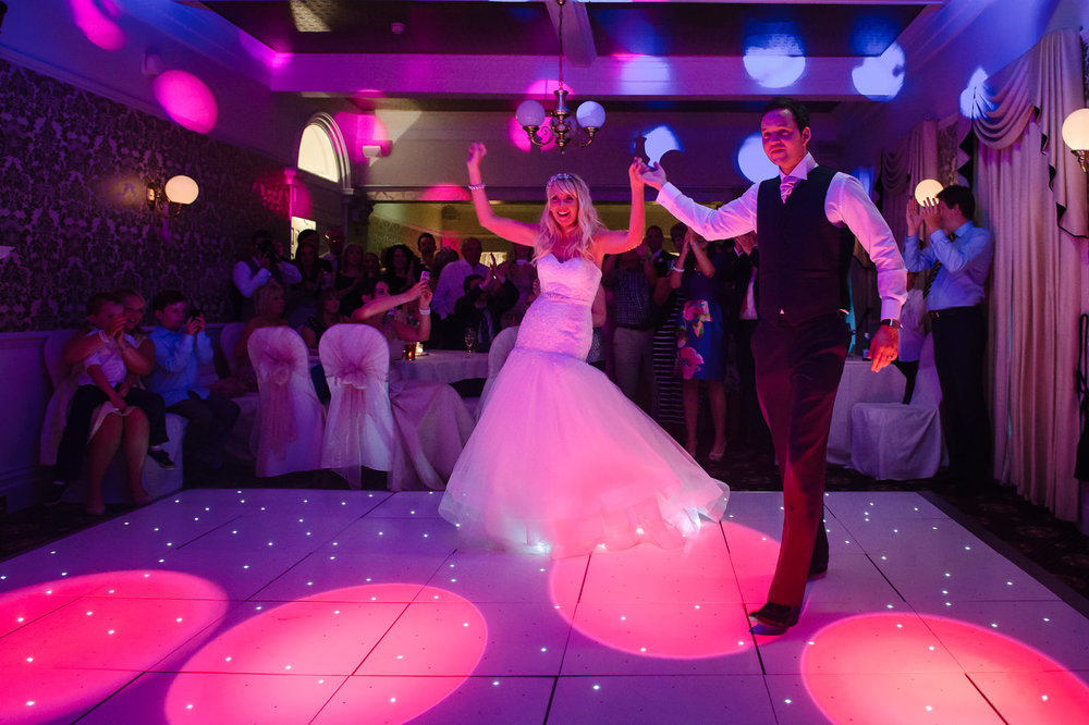 Ba bride and groom take to the dance floor for their first dance at Bartle Hall