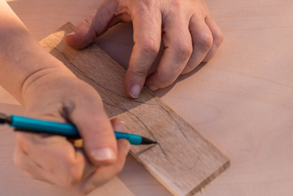 I suggest you first to draw on the paper, cut it out and then draw it on the wood. But you might want to skip it and draw immediately on the wood.
