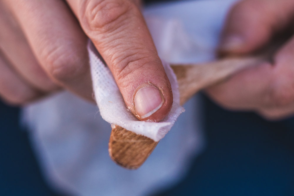Remove all the dust from the knife and apply the beeswax. I also use it as a moisture my hands which may go pretty dry from the sanding process.