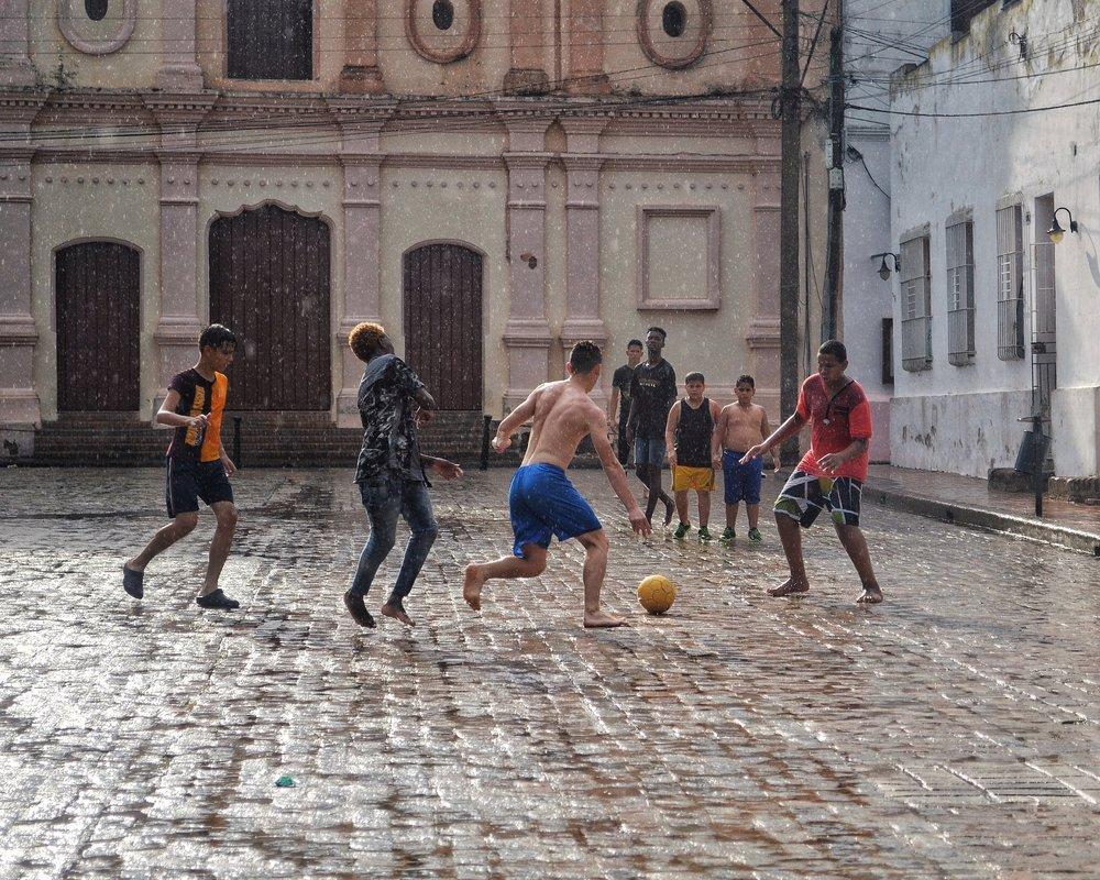 Football in the rain at Plaza del Carmen, Camaguey, Cuba