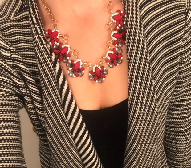 Another pop of red in the statement necklace