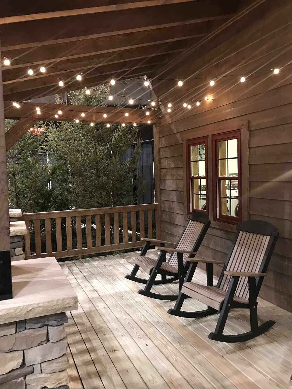 Hanging lights on front porch of model home