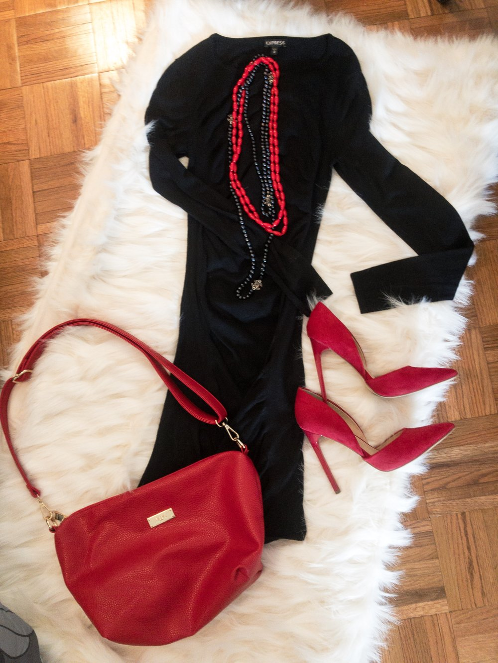 This simple black sweater dress from Express is immediately ready for V-Day with red accessories.
