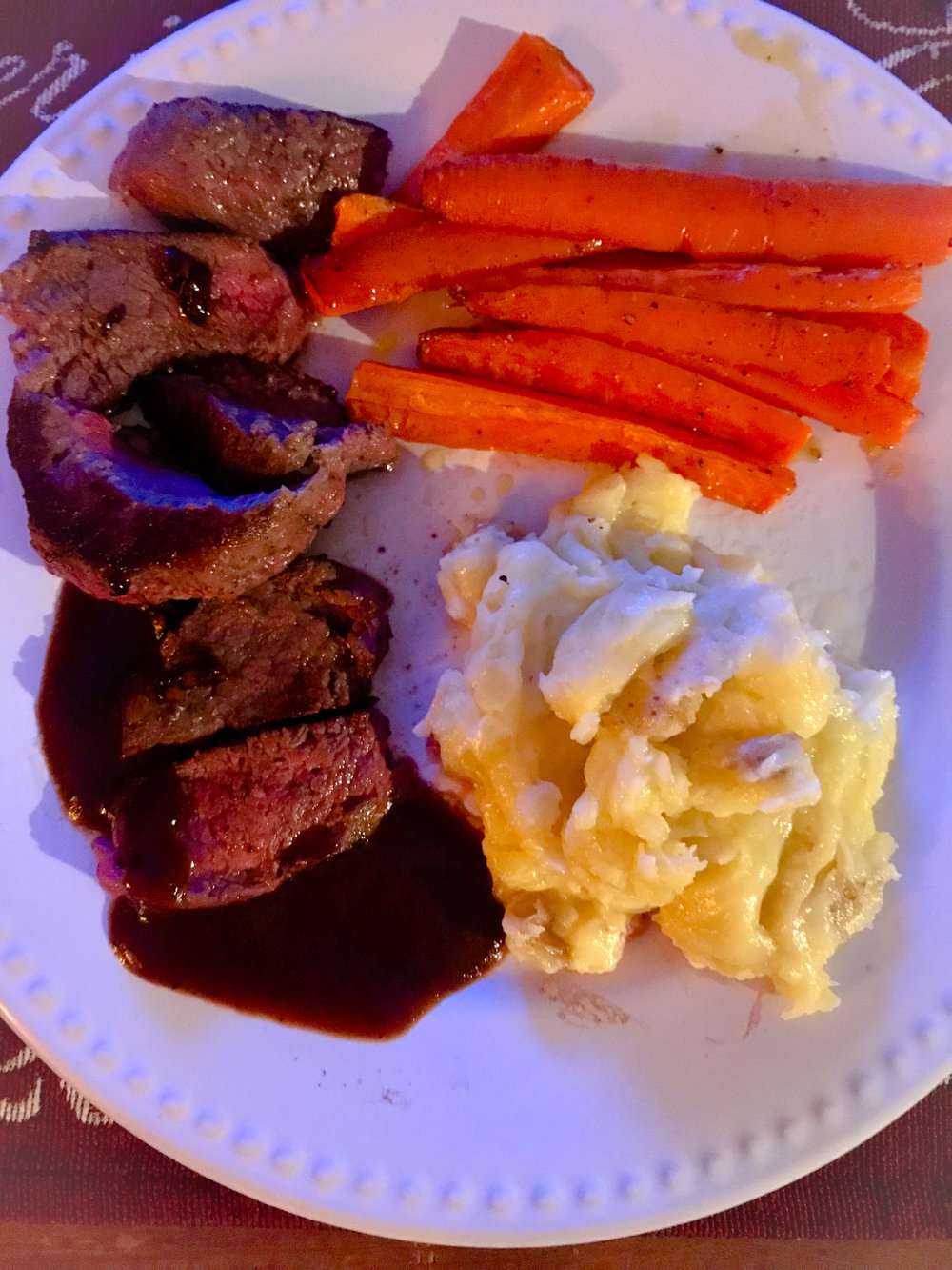 Final product of the steak with carrots and mashed potatoes. The cheesy mashed potatoes were soooooo good.