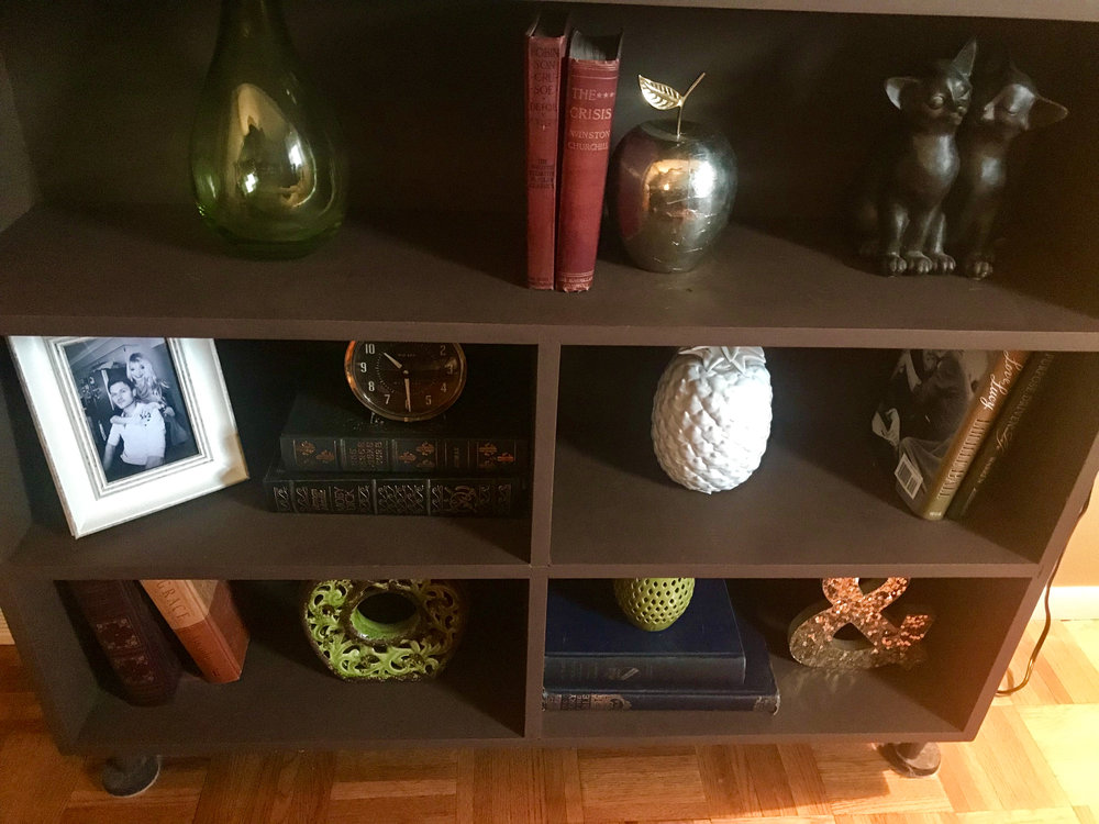A view of the fun items in my mid century bookcase from my grandma! It is definitely a mix of old and new :)