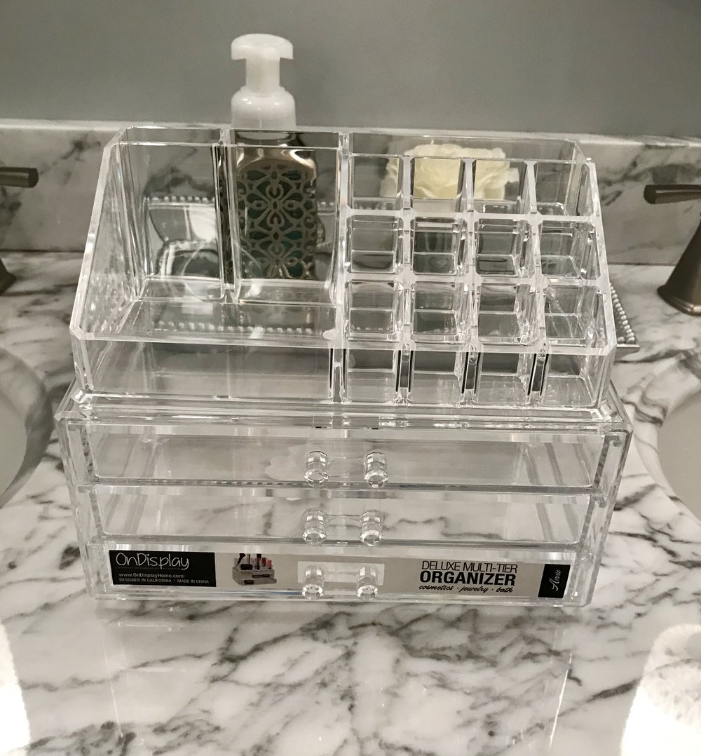 Another acrylic storage with more lipstick slots, drawers, and spaces for storage.
