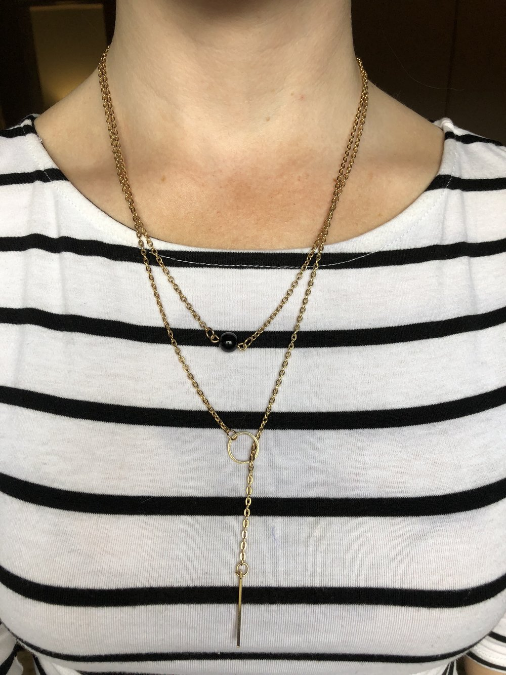 The lariat paired with the black onyx necklace over a simple striped tee.