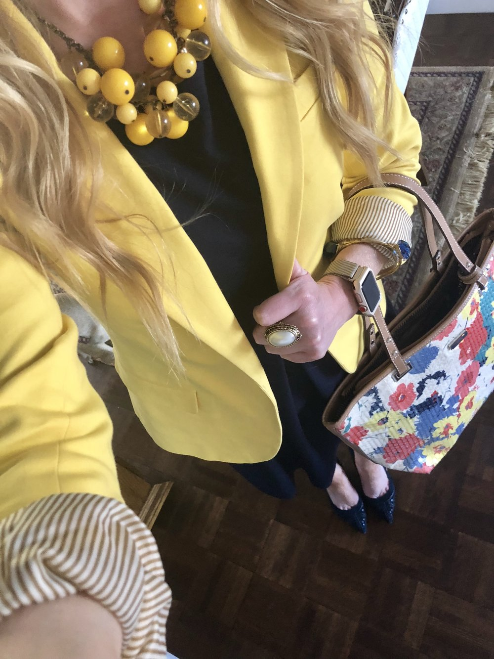 Loving this yellow blazer over a navy swing dress with a pop of floral for a great spring work wear look! All items are from my closet! I recently rediscovered the necklace and the bag in my spring cleaning!