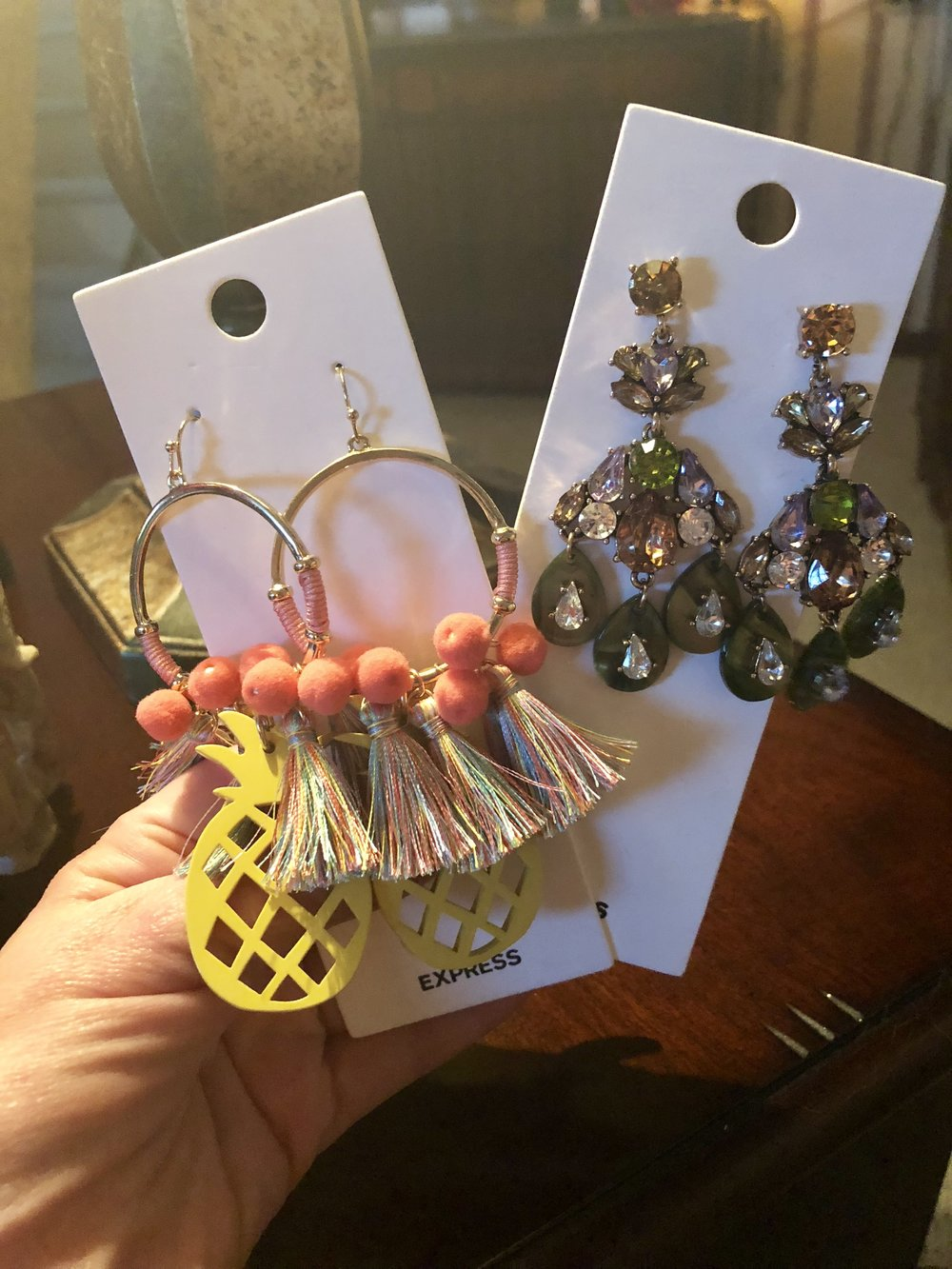 I recently purchased these at Express through use of a coupon and rewards!  As a result, I got both of these for less than $10.  I love pineapples and had to have these, and I never have a good pair of green earrings when I need them.  I linked up both pairs, along with some similar pineapple ones available!