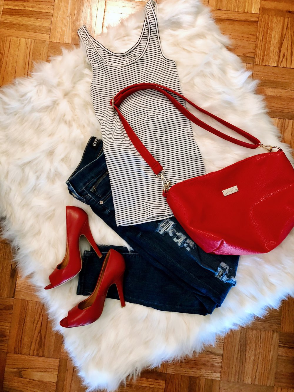 Loving how cute this basic striped tank looks paired with pops of red in the heels and bag!  As you know, this summer I'm showing all the different ways you can utilize older items in your closet!  This tank was from either last summer or the summer before.  I paired it with my favorite red peeptoe shoes and this fun BCBG bag that I got from a Clothes Mentor, a consignment shop!
