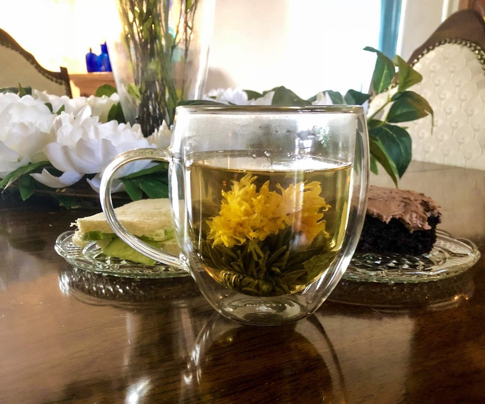 One of the tea blooms with a tea sandwich and cake!