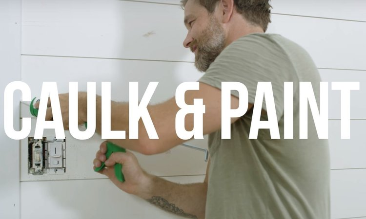STEP 6 - CAULK & PAINT || Caulk all nail holes and areas where the shiplap meets other moulding and the wall with a paintable caulk. Follow manufacturer's instructions on the tube. Once the caulk has set, touch up with paint.