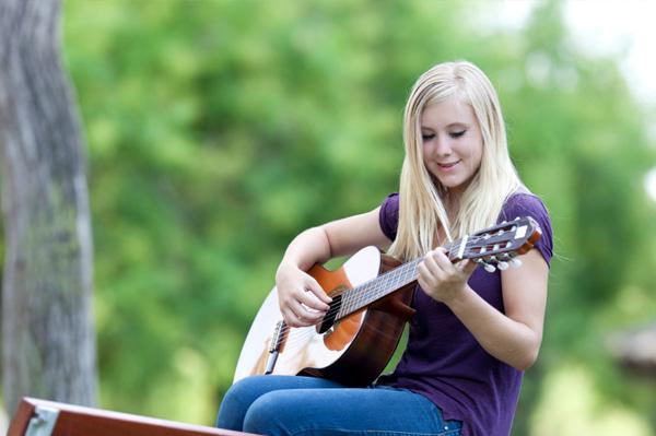 girl playing guitar.jpg