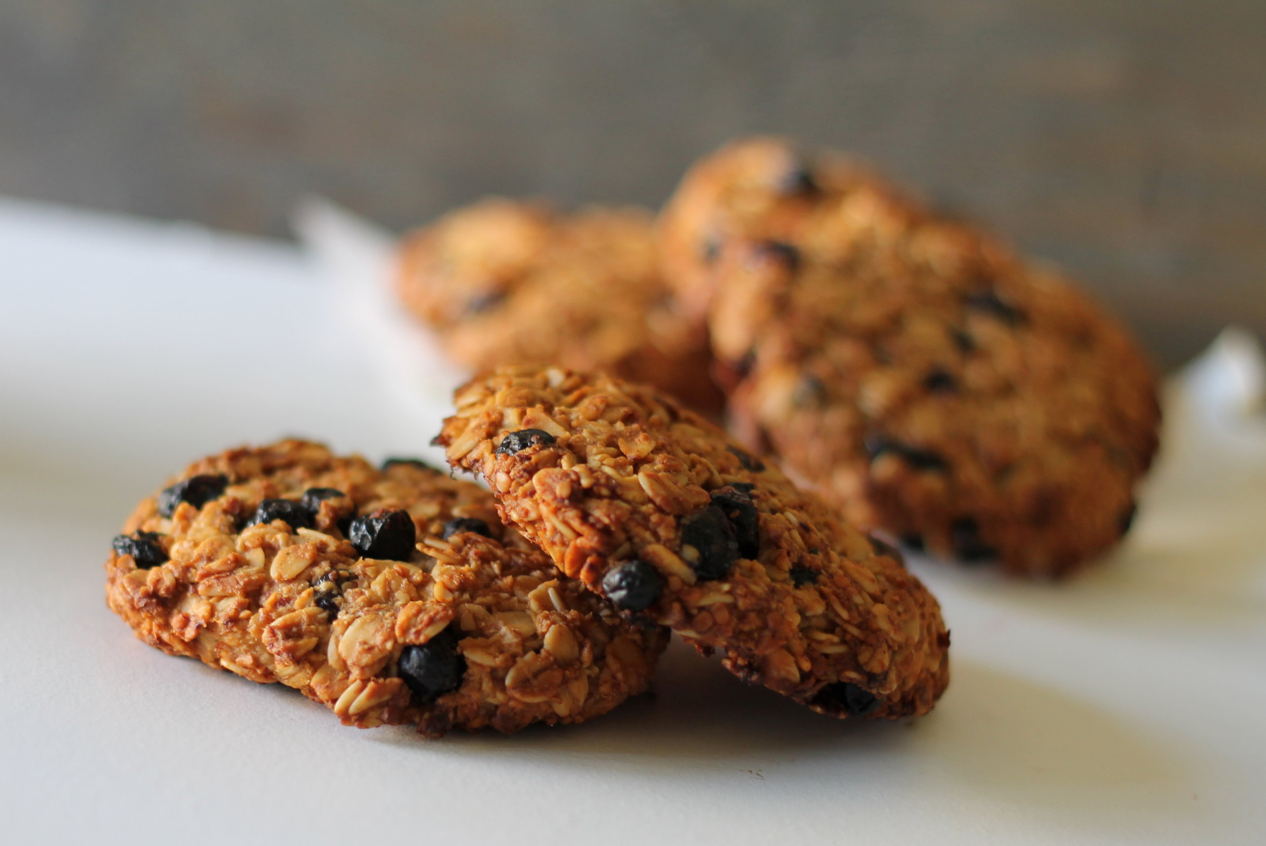 Wildblueberry Oatmeal Cookies are great for grab n' go breakfast or a snack. They are packed with nutritious ingredients like oats, almond flour, hemp seeds, and cranberries. Naturally sweetened, vegan, and gluten-free!