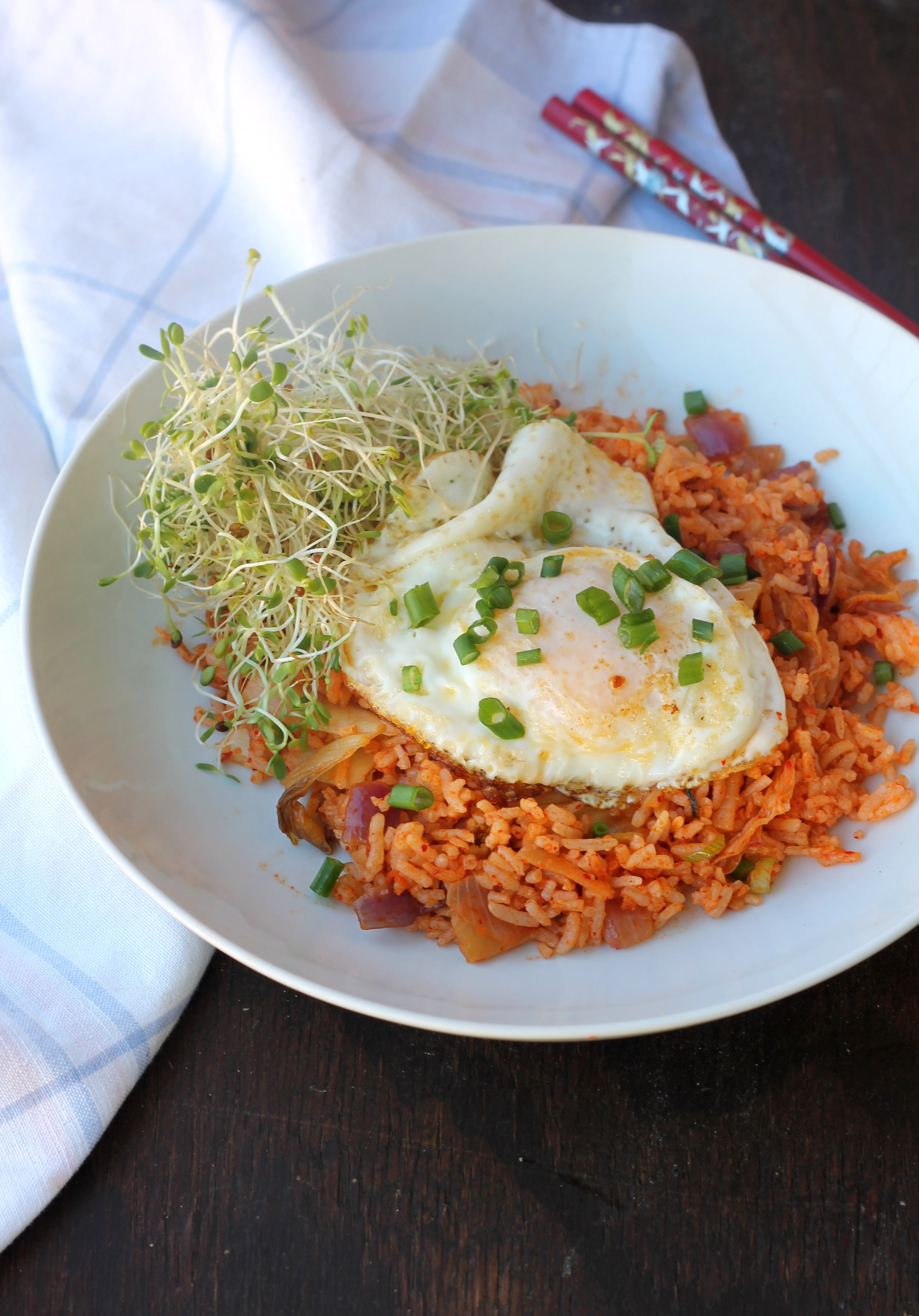 Kimchi Fried Rice is a simple, quick Korean inspired dish with rice & kimchi. You can enjoy it with eggs, tofu, or other meat for a wholesome meal.