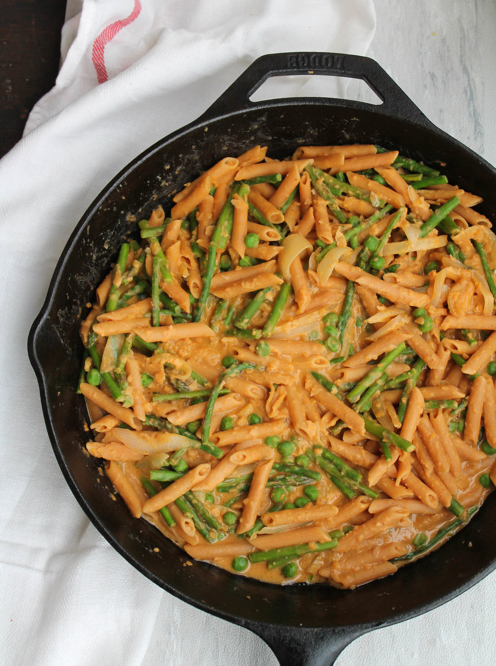 Vegan, Gluten-Free Spring Vegetable Hummus Pasta is what you need to welcome Spring! Great for a quick weeknight dinner and flexible with hummus and vegetables of your choice.