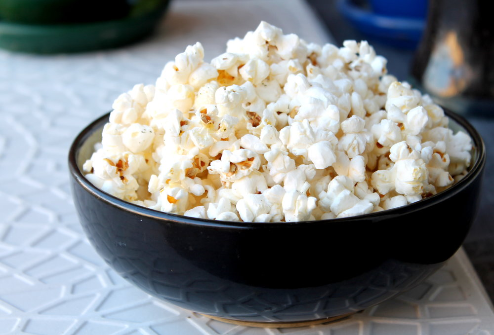 Stove-top popcorn is exactly what you need while binge watching tv - it's a nutritious snack, naturally gluten-free, vegan and literally takes 5 minutes to pop!