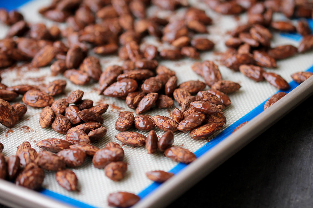 Roasted Almonds with Cocoa - just 3 ingredients, 15 minutes, one pan to make an easy, nutritious snack! Naturally vegan & gluten-free too.