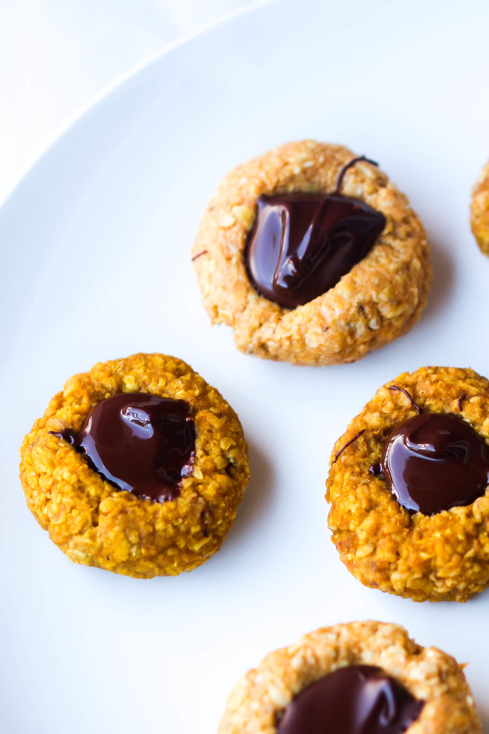 Oat and Pumpkin Thumbprint Cookies - Made in one bowl, great for snacking for both kids and adults. Naturally gluten-free, nut-free and can be made vegan friendly or raw.